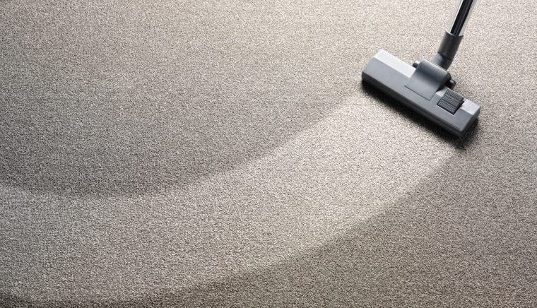 A vacuum cleaning a carpet