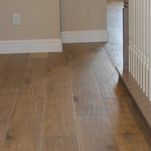 Straight plank fitted engineered wooden floor in house