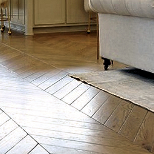 Wooden herringbone pattern floor in wood